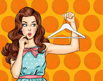 Pop Art thinking girl with hanger. Comic woman. Sexy girl. Amazed woman.Vintage advertising poster. Thinking woman