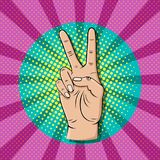 Pop art victory sign gesture Stock Images