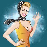 Pop Art winks woman with ok gesture . Pin-up girl. Fashion Sexy Beautiful  illustration Royalty Free Stock Image