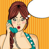 Pop art  woman chatting on retro phone . Comic woman with speech Royalty Free Stock Photography