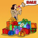 Pop Art Woman with Megaphone Promoting Big Sale Standing in Gift Boxes Royalty Free Stock Image