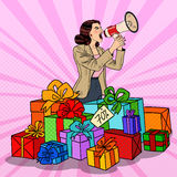 Pop Art Woman with Megaphone Promoting Big Sale Standing in Gift Boxes Royalty Free Stock Photo