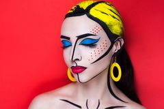 Pop art woman. New Creative woman lady girl model play comics blue red yellow colors. Bright conceptual art make-up glows light party time. Multicolored paints Royalty Free Stock Images