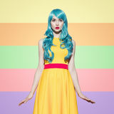 Pop art woman portrait wearing blue curly wig  Stock Photography