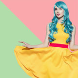 Pop art woman portrait wearing blue curly wig Royalty Free Stock Photo