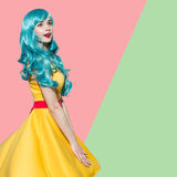 Pop art woman portrait wearing blue curly wig Royalty Free Stock Photography
