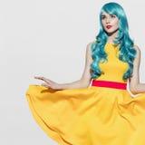 Pop art woman portrait wearing blue curly wig stock image