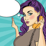 Pop art woman with retro phone Stock Photography