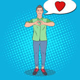 Pop Art Young Man Showing Heart Hand Sign. Love Comic Style Background. Vector illustration Stock Photo