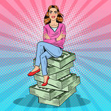 Pop Art Young Rich Woman Sitting on a Stack of Money. Vector illustration Royalty Free Stock Photo