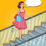 Pop Art Young Woman with Shopping Bags on Escalator. Sale Consumerism Royalty Free Stock Image