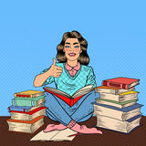 Pop Art Young Woman Sitting on the Library Table and Reading Book with Hand Sign Thumb Up. Vector illustration Royalty Free Stock Images