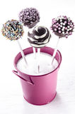 Pop cake with sprinkles in a pink bucket Stock Photography