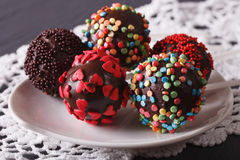 Pop cakes closeup on a white plate on the table. Horizontal Royalty Free Stock Image