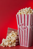 Pop Corn. Bags against red background royalty free stock images