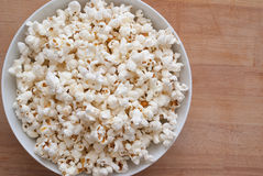 Pop Corn. On wooden Background Stock Photos