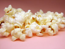 Pop corn. On pink background Stock Photos