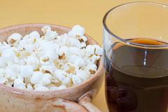 Pop corn in bowl and cola Royalty Free Stock Photo