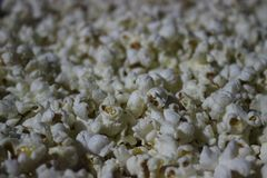 Pop corn - it is time for movie and good vibes. Pop corn- The cinema nights are not the same without them Stock Photos