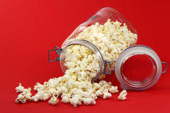 Free Pop Corn Coming Out Of A Glass Jar Stock Photography - 13931602