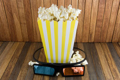 Pop corn and 3d glasses on wood background stock image