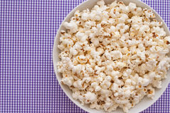 Pop Corn. Delicious Pop Corn on violet background Stock Photography