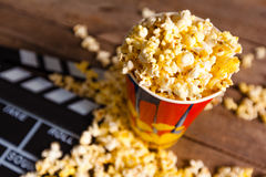 Pop corn. Movie clapper board and pop corn Stock Images