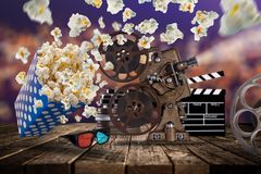 Pop-corn, movie tickets, clapperboard and other things in motion. Stock Photo