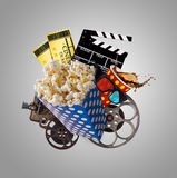 Pop-corn, movie tickets, clapperboard and other things in motion. Cinema concept Stock Photos