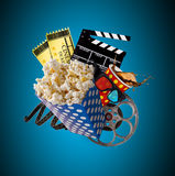 Pop-corn, movie tickets, clapperboard and other things in motion. Cinema concept Stock Images