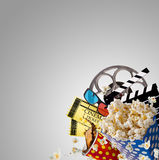 Pop-corn, movie tickets, clapperboard and other things in motion. Cinema concept Stock Image