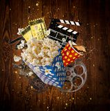 Pop-corn, movie tickets, clapperboard and other things in motion. Royalty Free Stock Photo