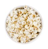 Pop corn pile in a round plate isolated on white background., top view stock photos