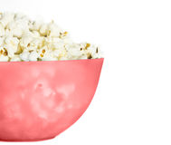 Pop corn. In pink pucket on white background Stock Image