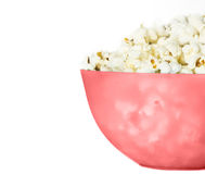Pop corn. In pink pucket on  white background Royalty Free Stock Photography