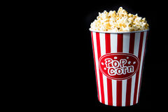 Pop corn. In bucket on black background royalty free stock image