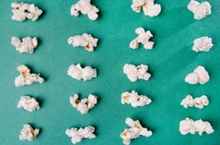 Pop corn. Composition in green background stock image