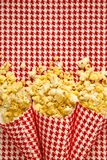 Pop corn on red background Stock Photography