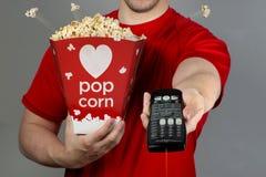 Pop Corn and Remote Control. Stock Image