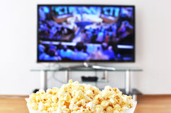 Pop-corn and TV Royalty Free Stock Images