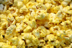 Pop corn up close. Close up image of fresh butter popcorn Stock Photos