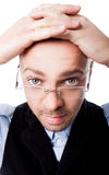 Pop-eyed мan glasses hands on head Royalty Free Stock Images