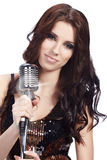 Pop female singer. With the retro microphone Royalty Free Stock Photography
