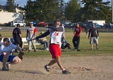 Pop Fly. Batting action in an Army vs. Marines annual softball tournament royalty free stock photography