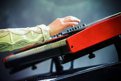 Pop music. Electric piano player hand Stock Images