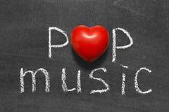 Pop music. Phrase handwritten on blackboard with heart symbol instead of O Royalty Free Stock Photo