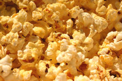 Pop Pop Pop Corn. Popcorn close-up, nicely buttered royalty free stock images