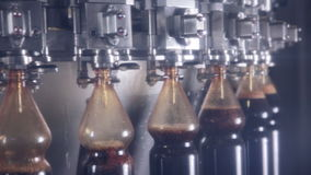 Pop and Soda, carbonated drink pouring in bottles on fresh drinks automated conveyor.