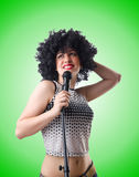 Pop star with mic  on white Stock Image
