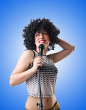 Pop star with mic  on white Stock Photo